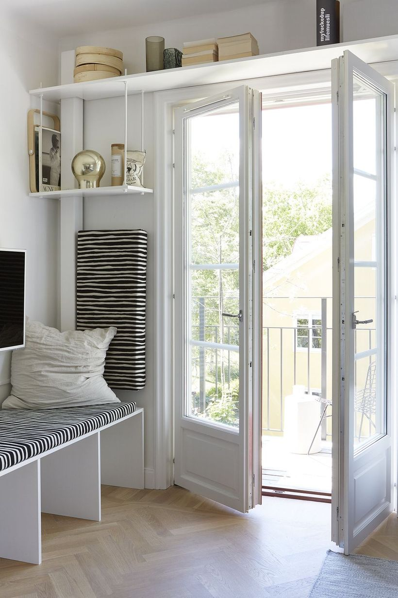 Inspired-comfortable-white-entryway-with-a-long-hanging-rack-above-the-door-to-store-some-small-objects