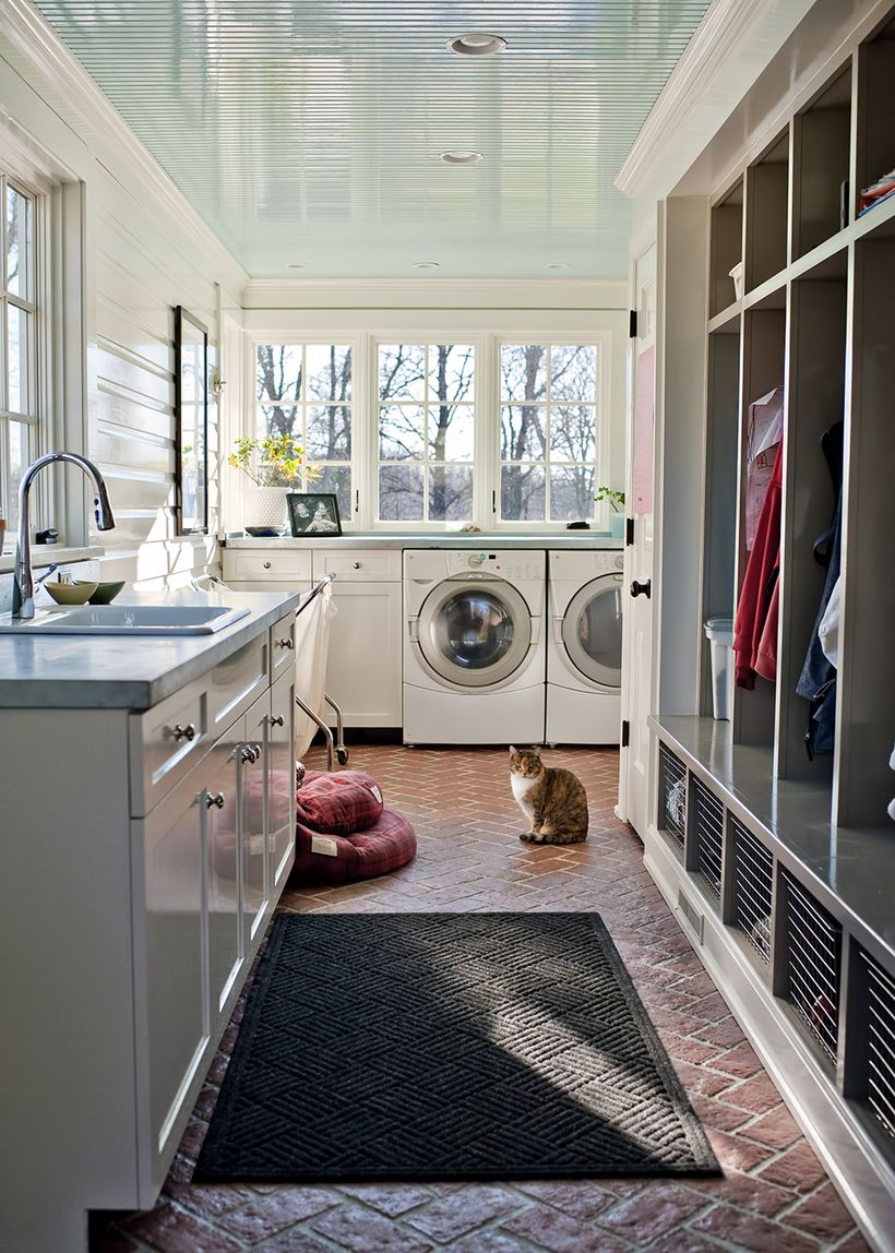 Laundry room with white cabinet and white sink