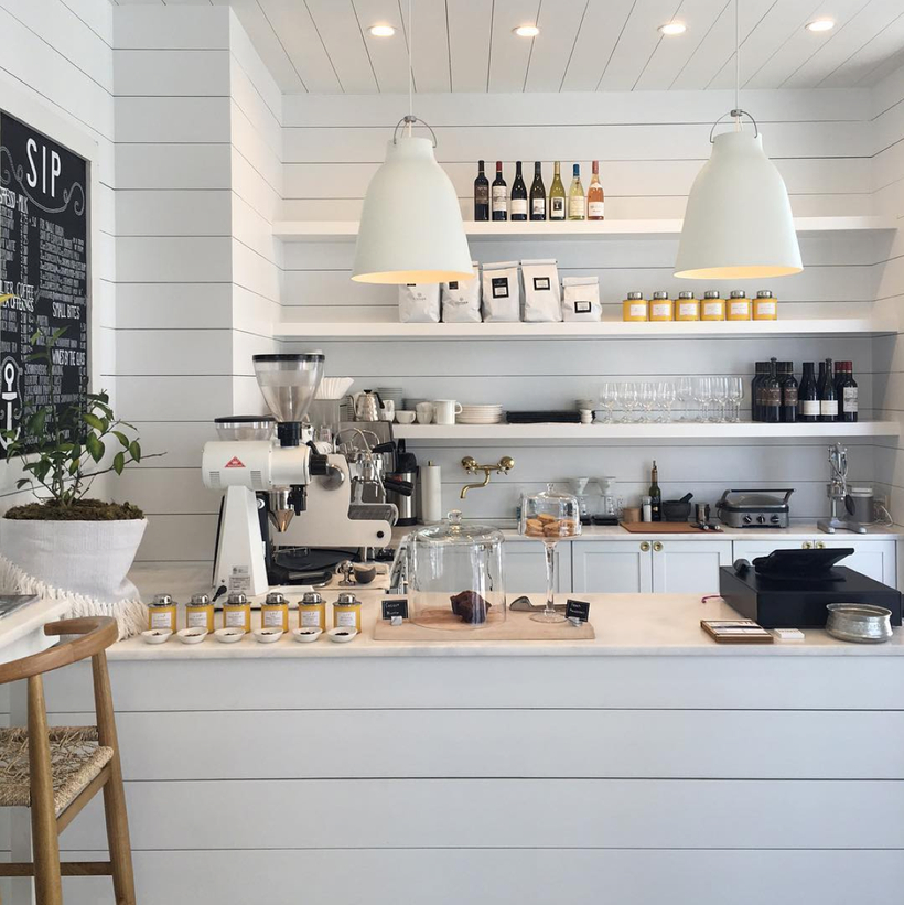 Marble-texture-background-white-home-accessories-decor-bright-coffee-shop-retail-store-in-florida-called-outpost-modern-interior-floor-design-shiplap-wall-faux-decoration-pieces