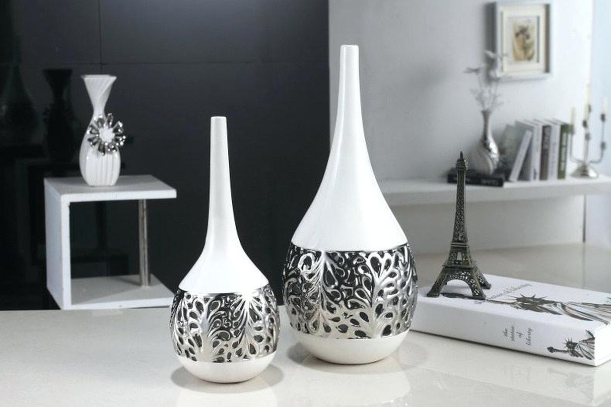 Modern-flower-vase-living-room-ornaments-with-unique-silver-and-white-carvings-for-decorating-your-living-room-table