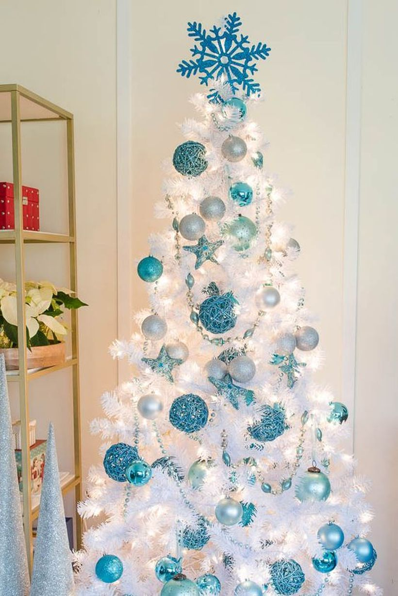 Pure-white-christmas-tree-looks-amazing-with-blue-bell-ornaments-of-various-shades-and-snow-ornaments-at-the-top