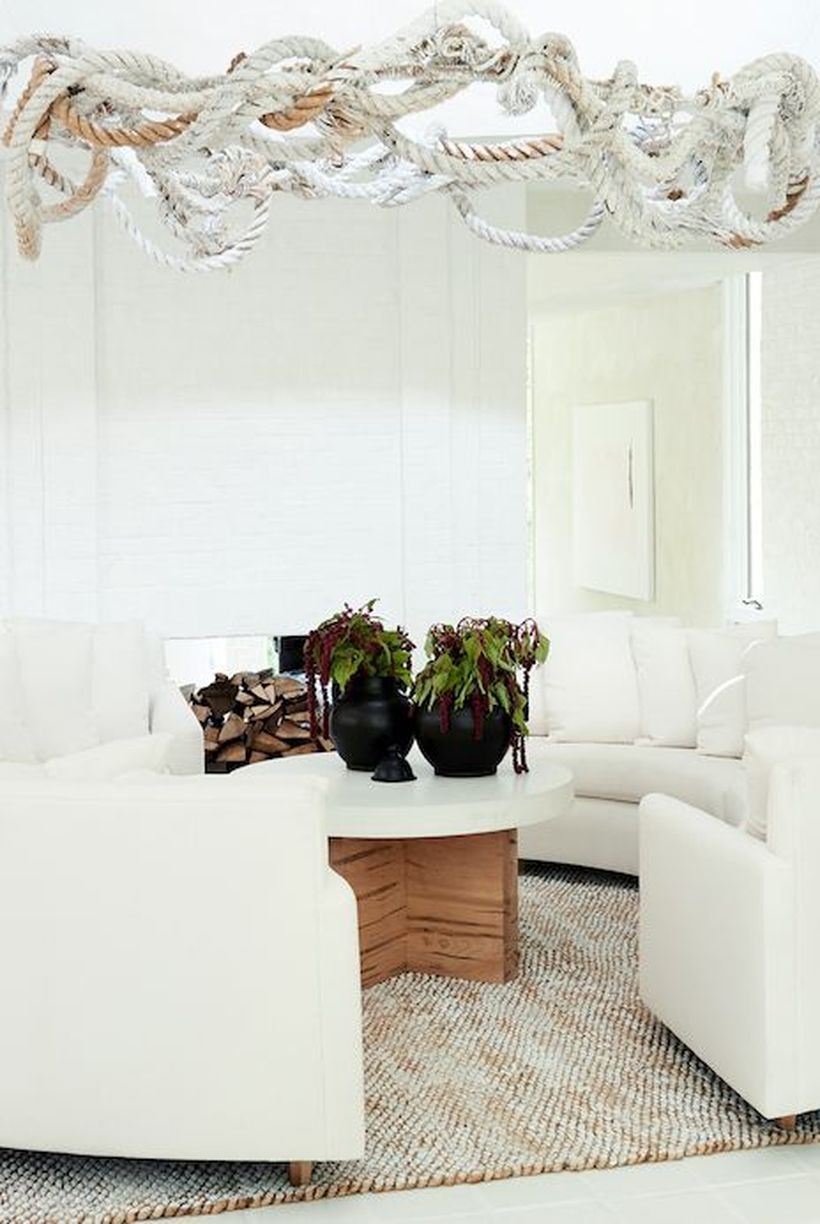 Round-coffee-table-and-white-sofa