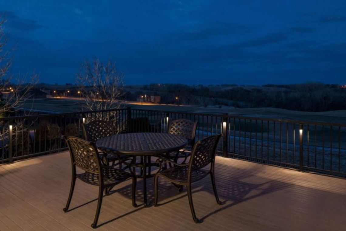 Simple-rooftop-decor-with-black-iron-rooftop-fence-added-a-few-lights-attached-to-the-beeper-to-light-up-your-rooftop