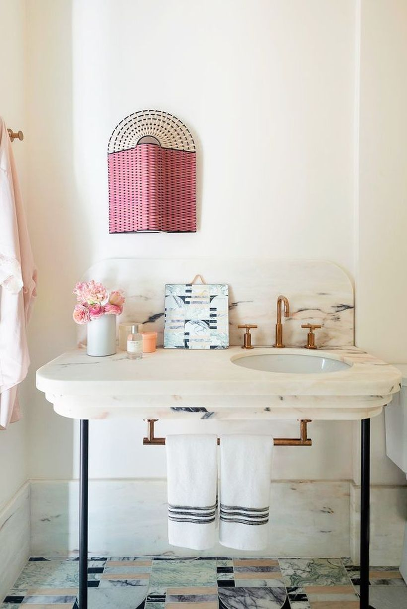 Small-bathroom-design-with-minimalist-granite-table-sink-and-towel-hook-under-the-sink