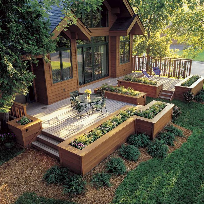 The-black-iron-chair-and-round-coffee-table-topped-with-flower-vases-to-make-it-more-attractive-to-your-patio-deck