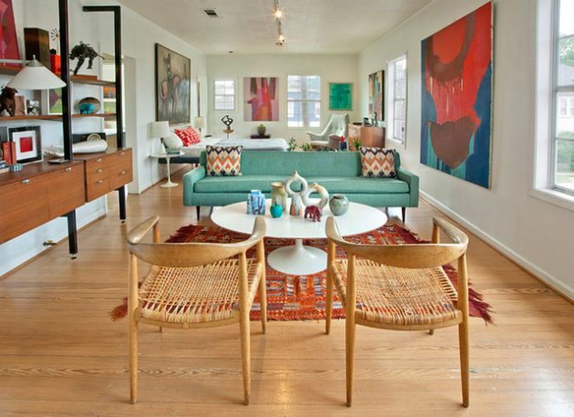 Unique-chairs-made-of-rattan-and-wood-with-white-round-coffee-tables-on-top-decorated-with-various-unique-ornaments-for-your-retro-living-room-decoration