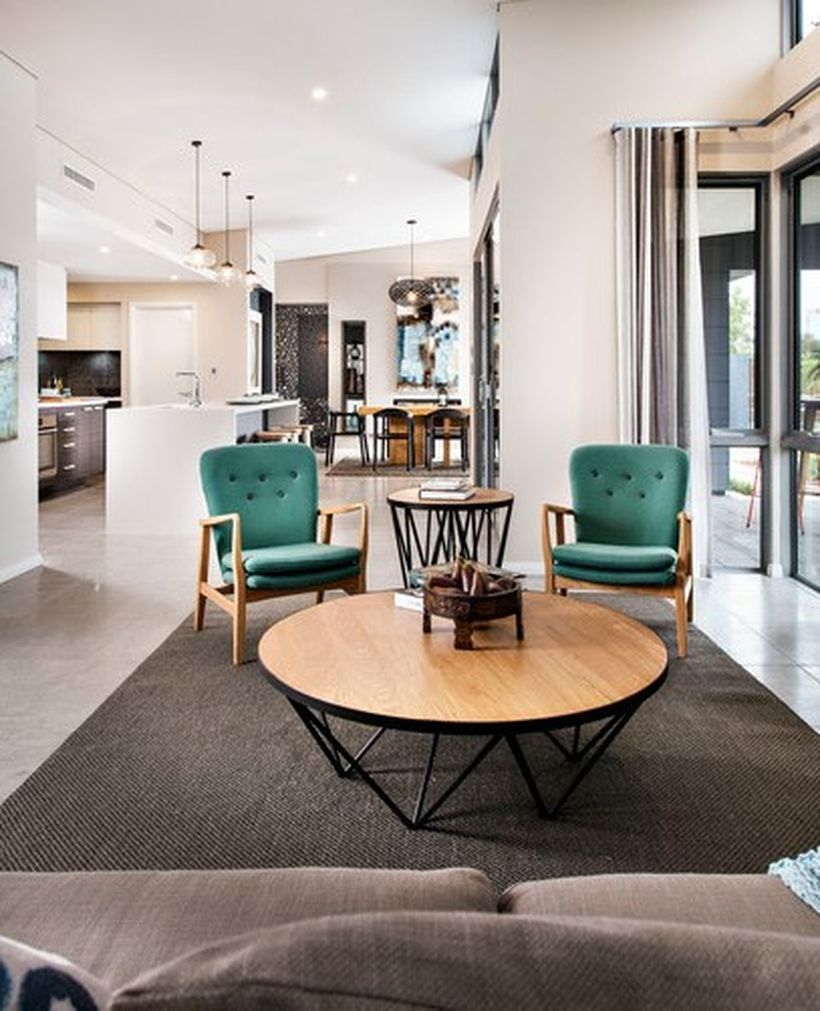 Unique-round-coffee-table-bergaya-retro-untuk-ruang-tamu-anda-with-wooden-frame-chair-and-green-soft-foam-agar-nyaman