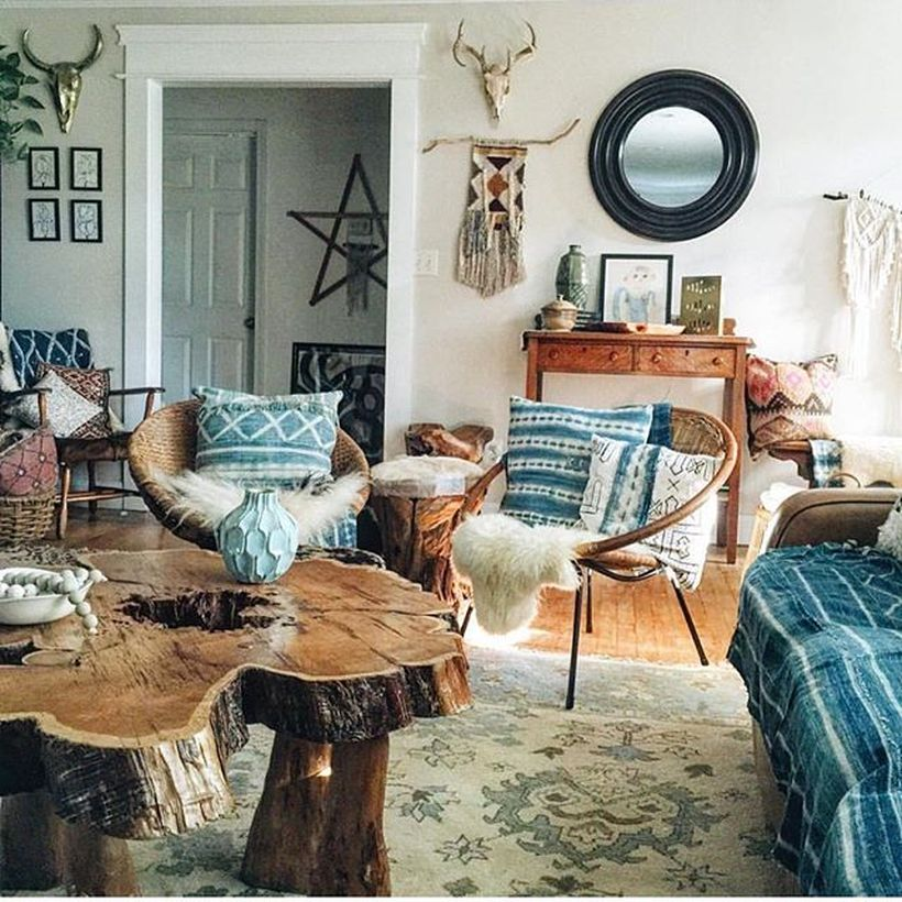 Unique-wooden-coffee-table-and-lazy-chair-to-create-a-bohemian-atmosphere-by-adding-unique-rugs-to-decorate-your-room