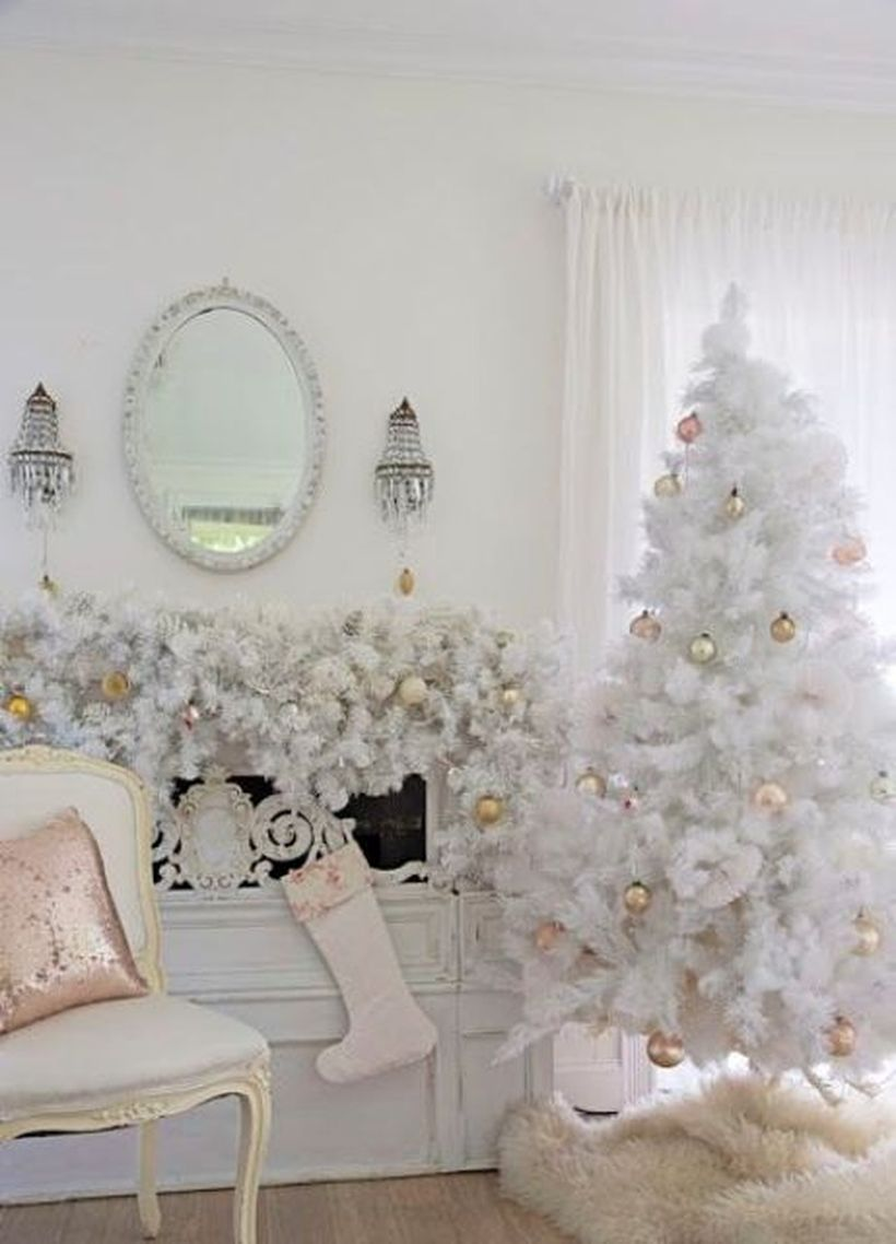 Vintage-white-christmas-tree-with-gold-ornaments-and-a-beautiful-garland-over-coat