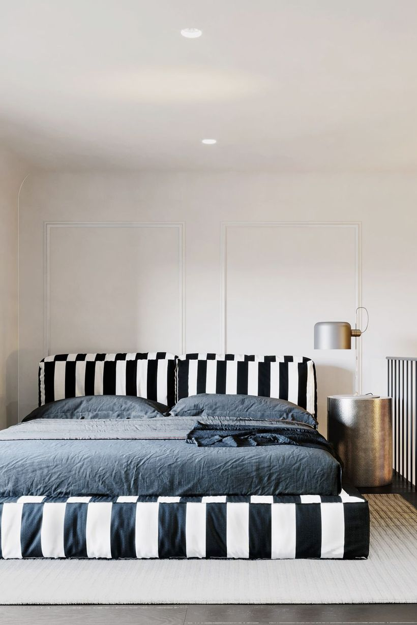 White-and-black-striped-bedroom-with-stainless-night-stand-and-unique-table-lampu-di-samping-tempat-tidur-to-create-good-lighting