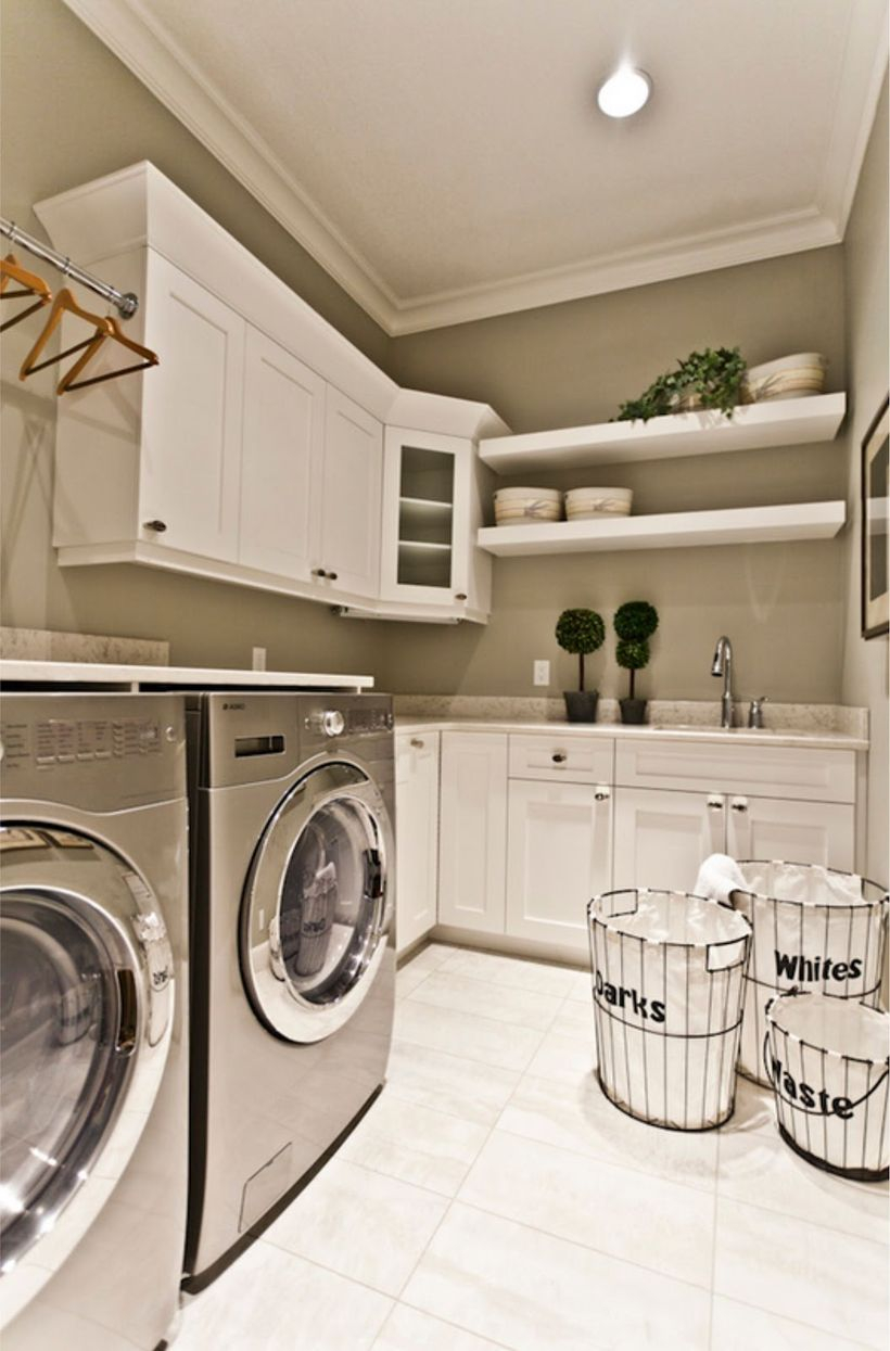 White laundry room with white cabinet and white basket