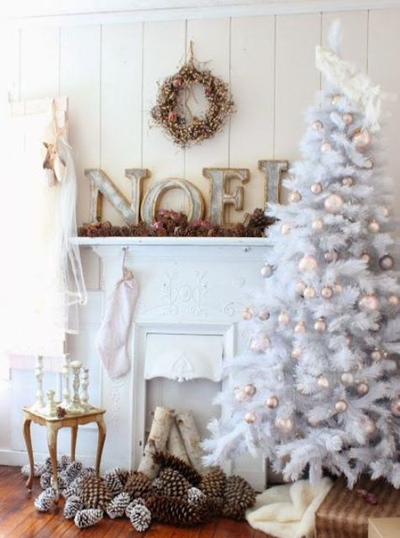 White-tree-with-soft-pastel-bell-ornaments-and-pinecones-for-balanced-decor-in-your-living-room