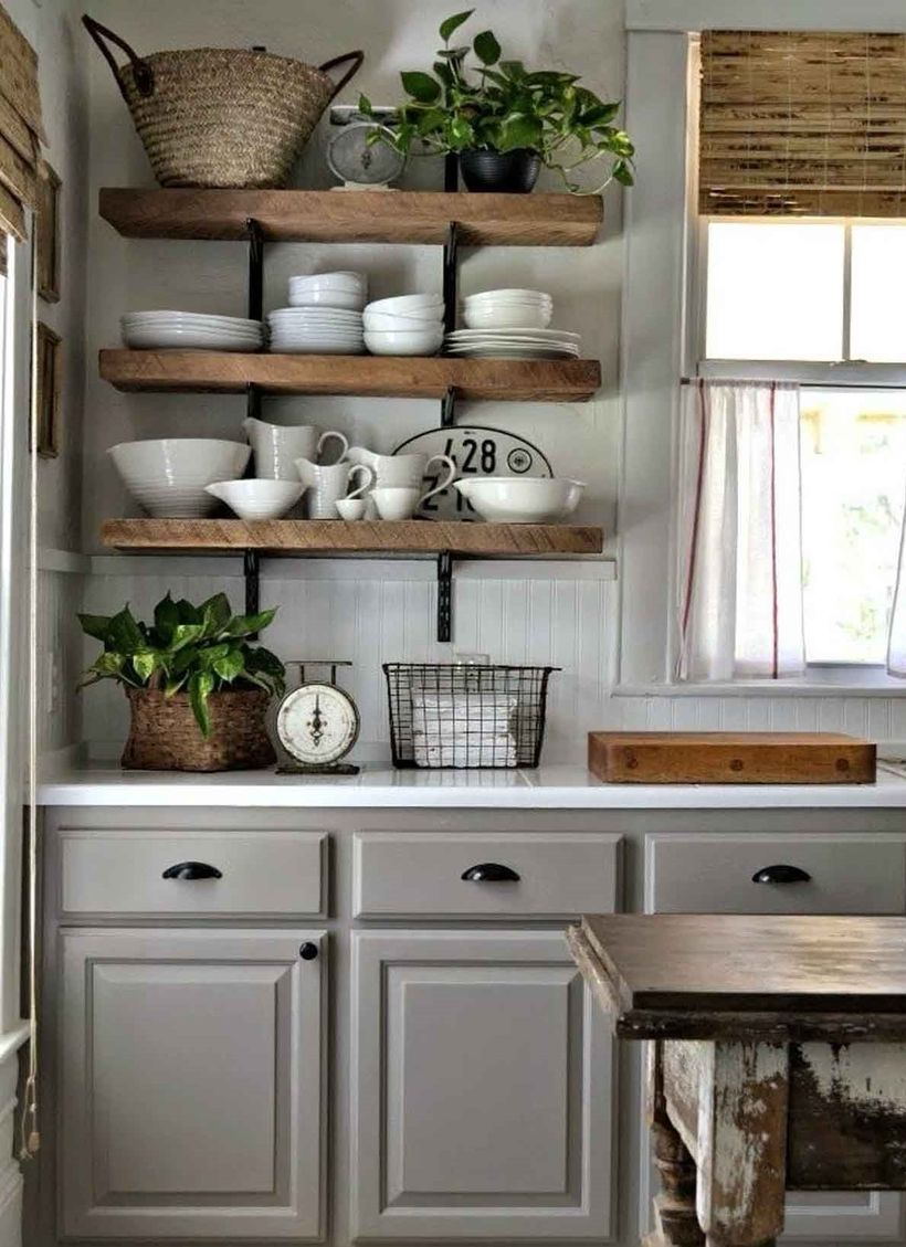 Wooden-thick-hanging-rack-furniture-that-must-be-in-vintage-kitchen-to-store-various-dishes-and-houseplant-at-the-top