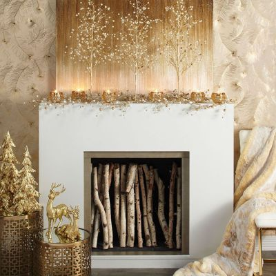 An elegant fireplace with gold decoration