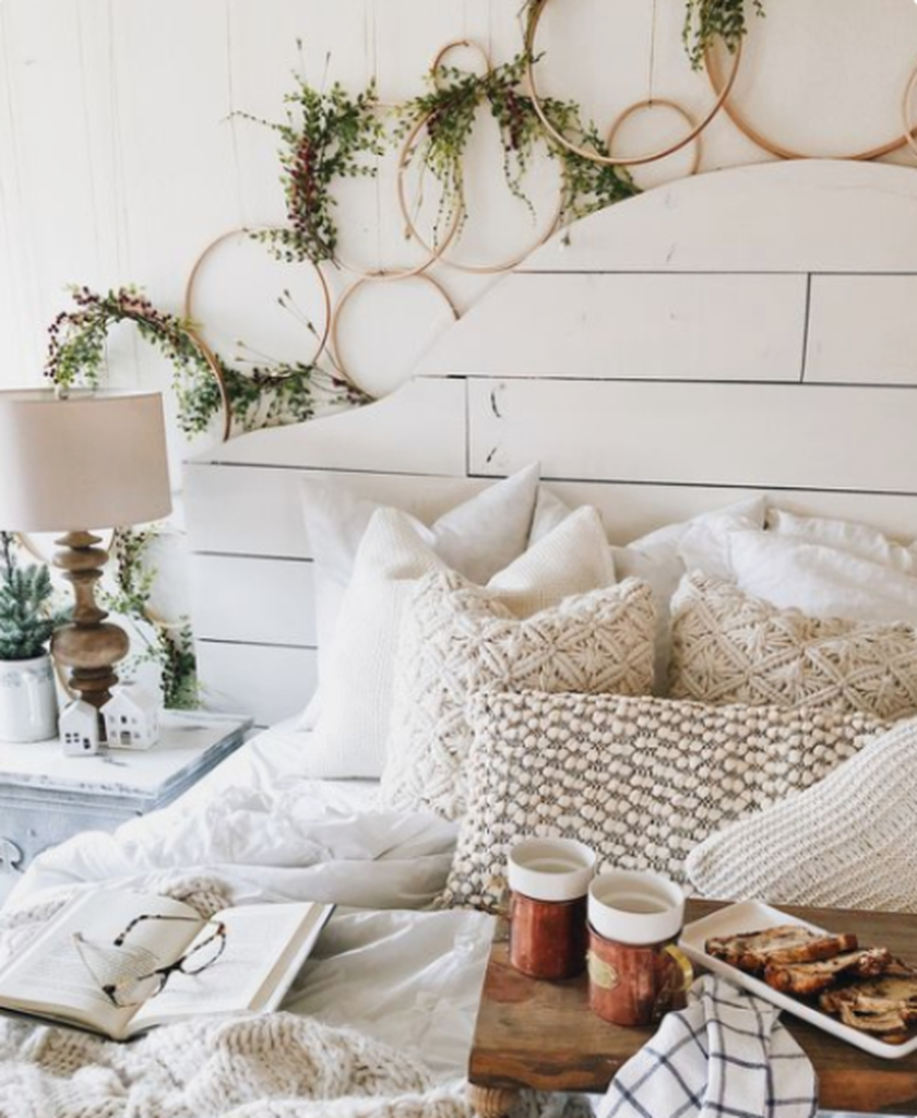 Bedroom design with greenery, knit and crochet pillows and blankets