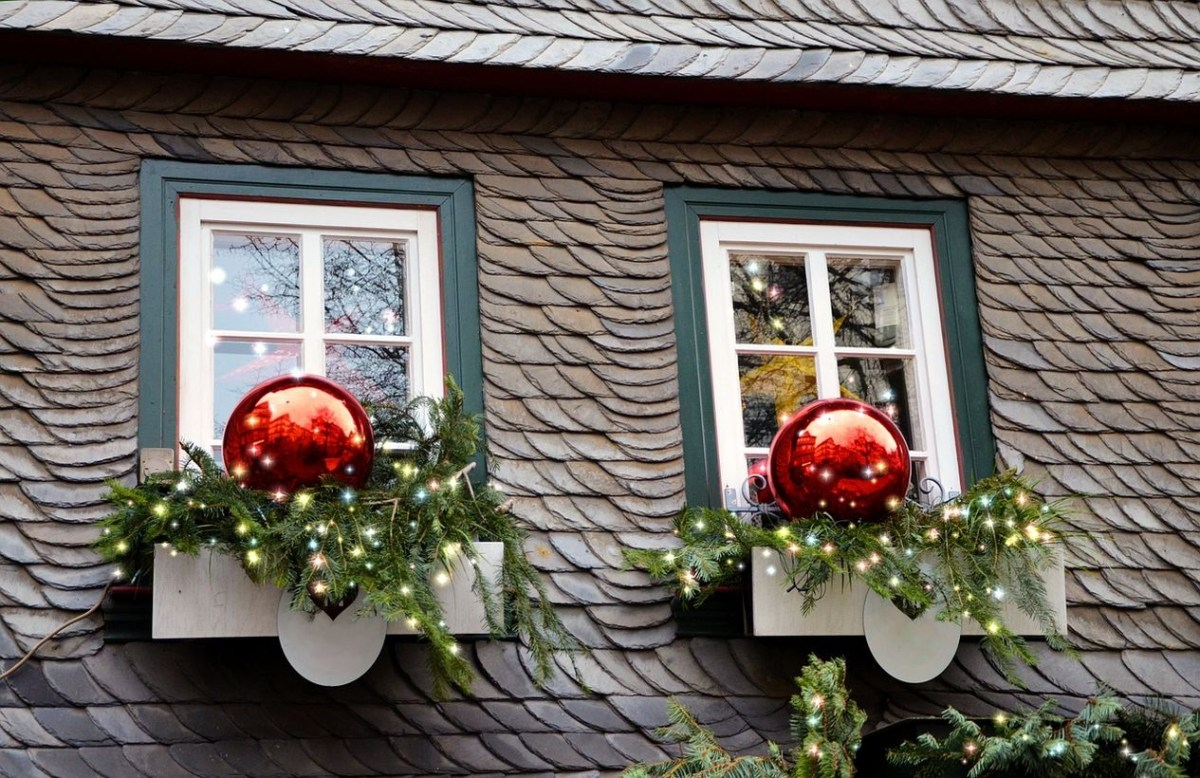 Big red ornament with green leaves and light