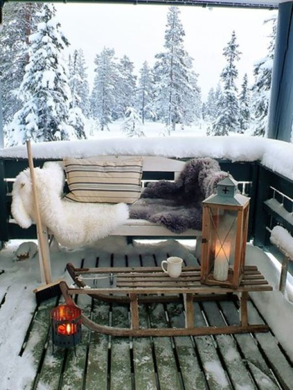 Decorate-the-balcony-with-warm-and-cozy-i'm-feeling-fuzzy-and-warm-just-looking-at-the-has-placed-a-sled-in-place-of-the-center-table.-and-the-chair-is-laid-with-furry-blankets.