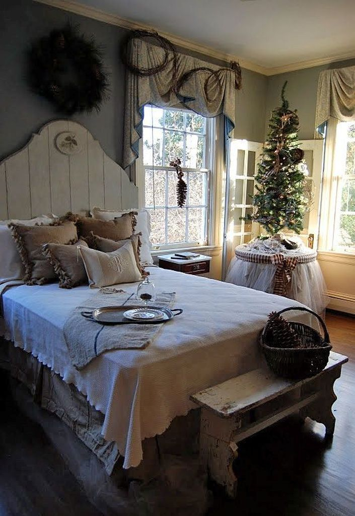 Farmhouse bedroom with christmas tree at the corner
