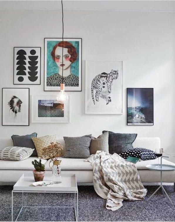 Gallery-walls-come-in-all-shapes-and-sizes-so-rather-than-going-with-an-undersized-assortment-that-doesnt-get-the-job-done-or-trying-to-fill-the-space-with-dozens-of-smaller-frames.