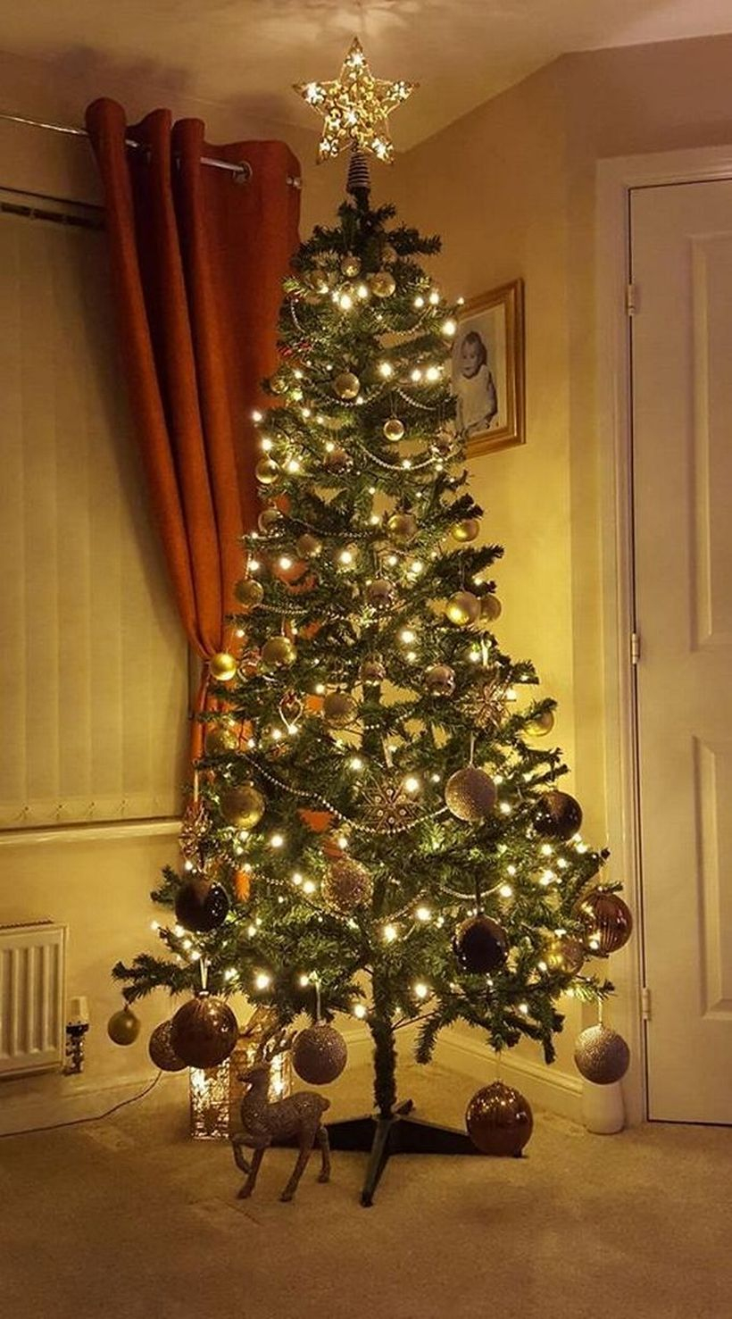Green chrismast tree with gray ornament and yellow light ideas