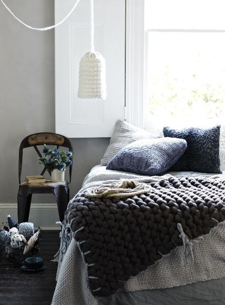 Modern bedroom design with knit pillows in various shades