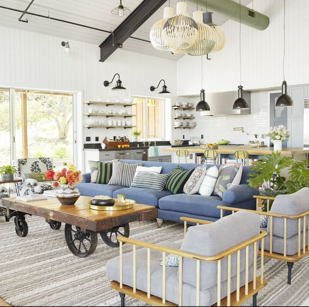 Modern farmhouse living room with blue sofa and unique table to complete your living room