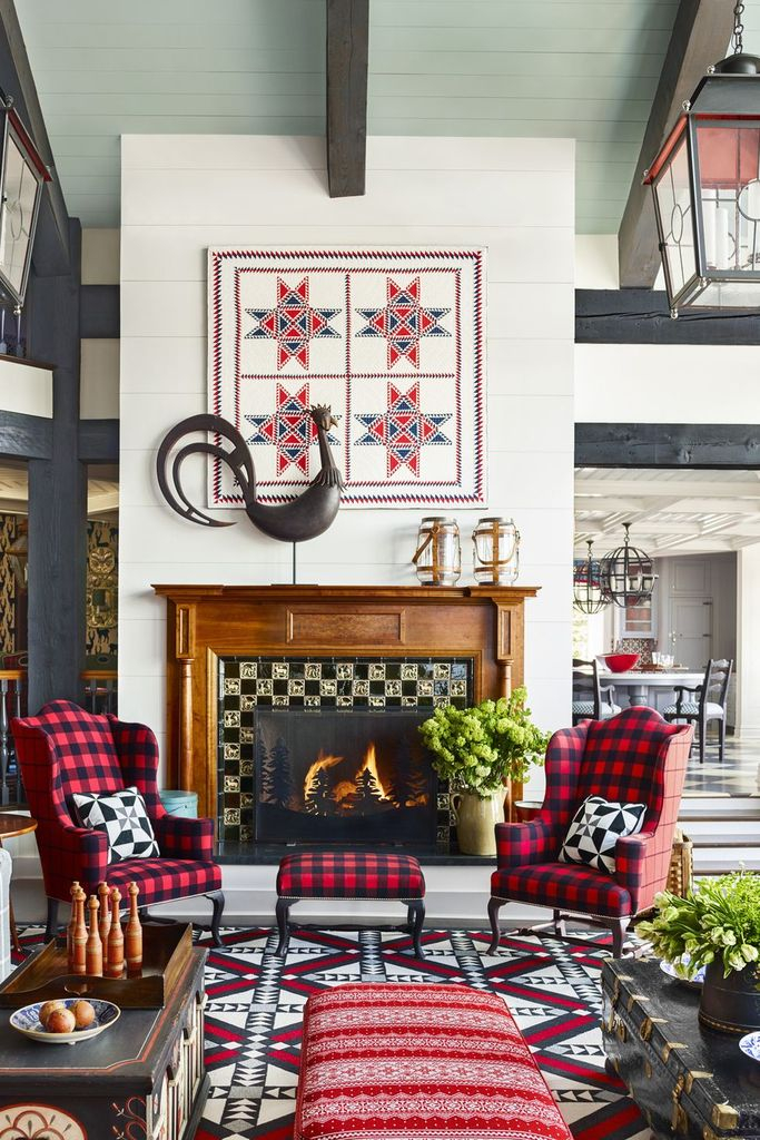 Modern living room design with wooden table and plaid chairs in black and red to make more a beautiful living room decoration