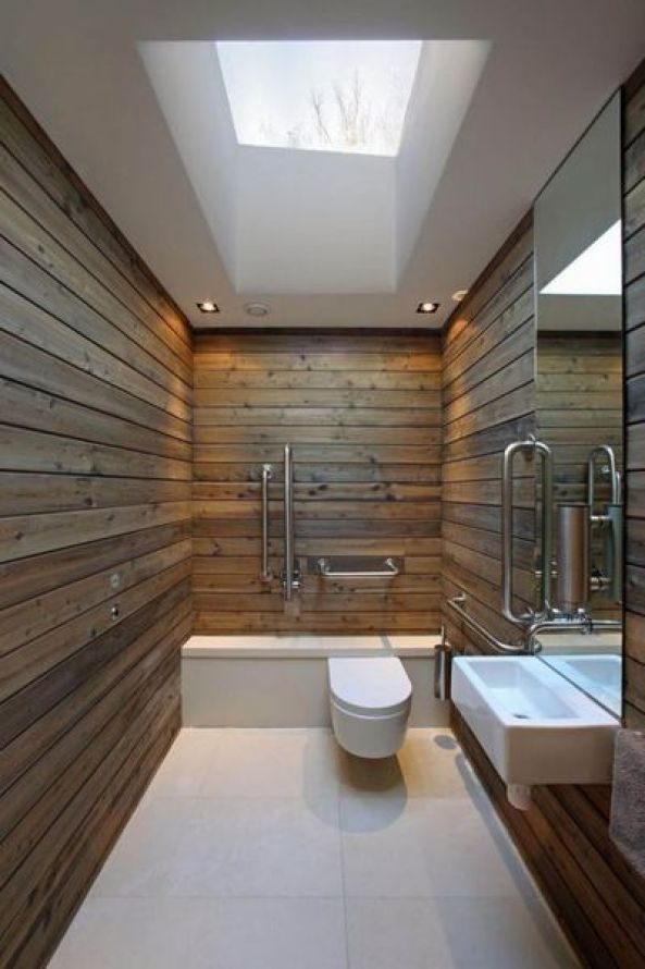 Modern-minimalist-airy-bathroom-with-stained-wood-plank-wall-panel-square-skylight-window-interior-design-ideas-simple-modern-bathroom-design-ideas-683x1024