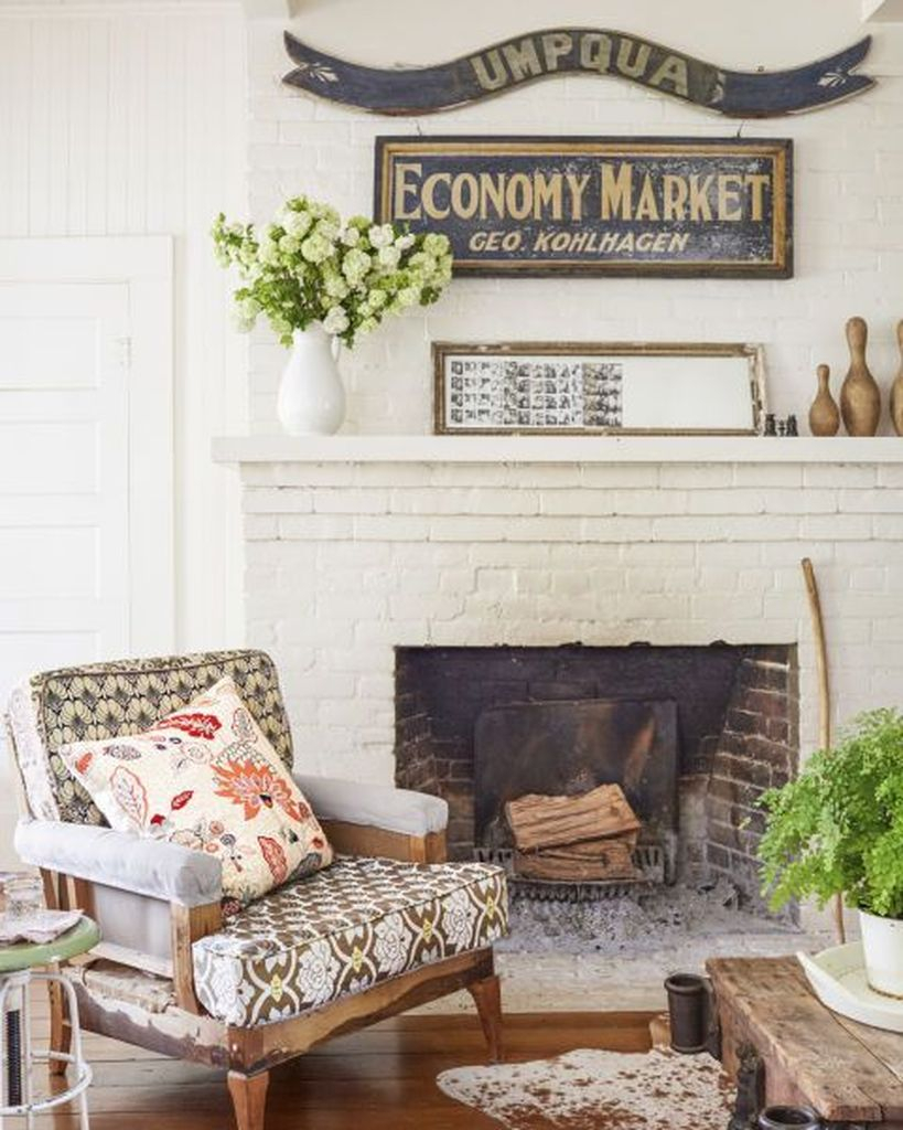 Patterned chair beside fireplace combined with wooden table to make an elegant your farmhouse living room