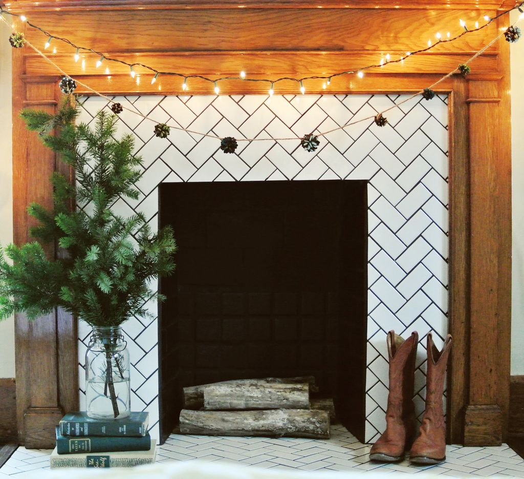 Perfect fireplace combined with pine cone garland and string lamps