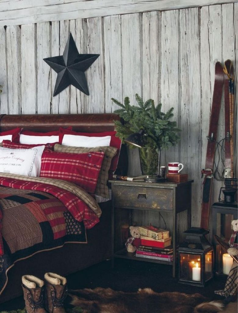 Rustic bedroom with a faux fur rug, an evergreen arrangement