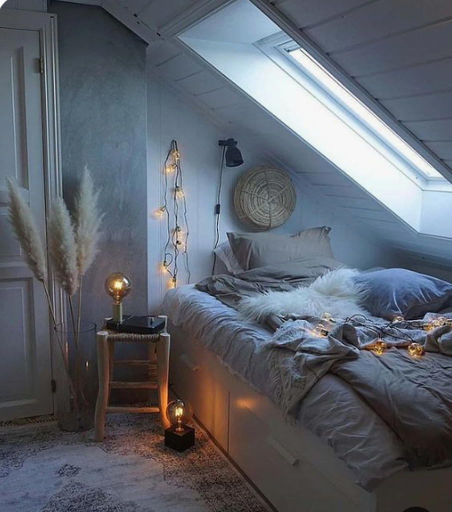 Small loft bedroom with simple decorative lighting