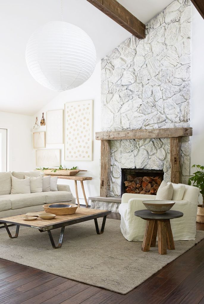 Stone fireplace in white combined with wooden frame