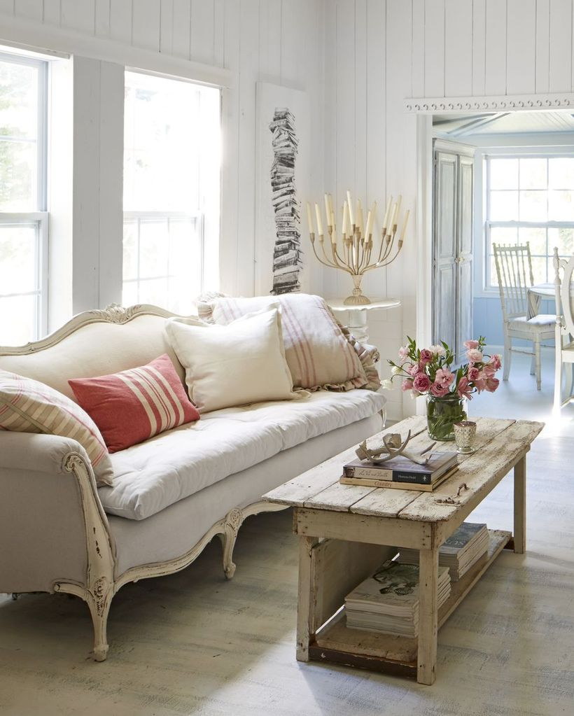 Stripped white and red cushion with white sofa