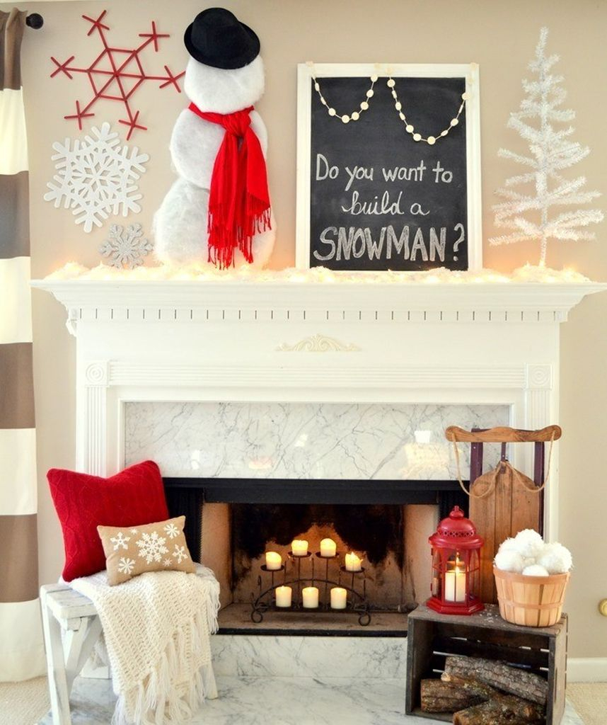White snowmen decoration to perfect your fireplace