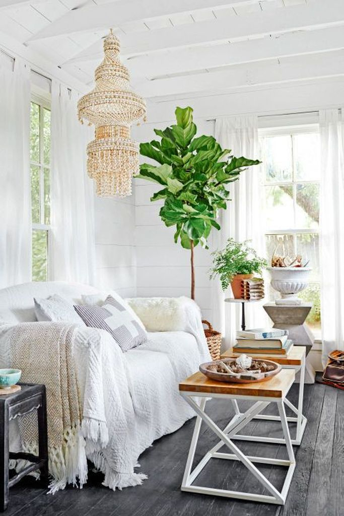 White sofa and iron coffee table combined with plants decoration to make more natural your living room