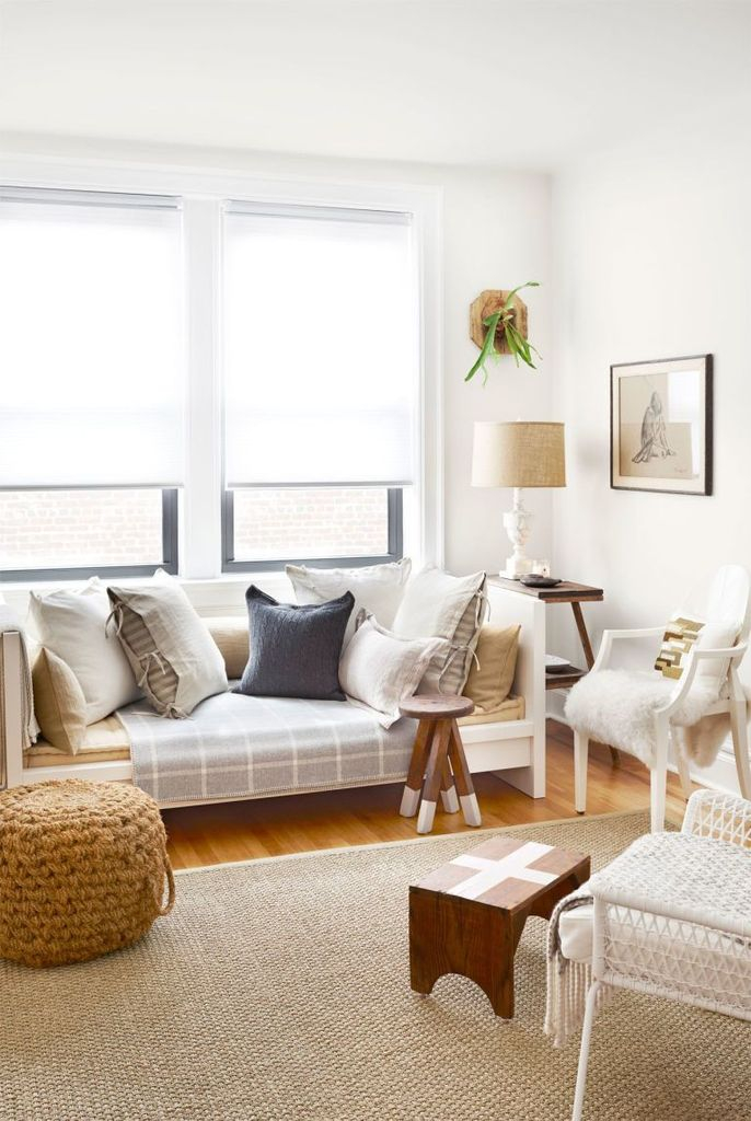 White walls combined with brigth sofa for small living room