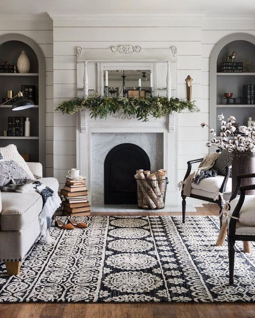 Winter fireplace with greenery and candle holder