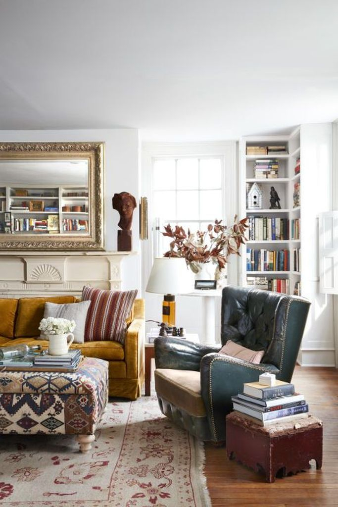 Yellow sofa and patterned table combined with dark chairs to make a classy your farmhouse living room
