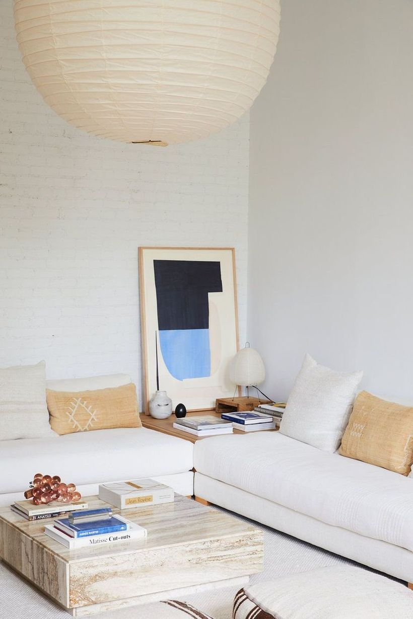 Brown and white cushion with white sofa