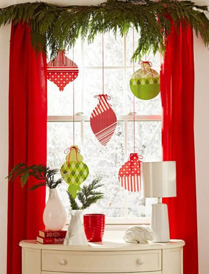 Christmas window with colorful hanging ornament