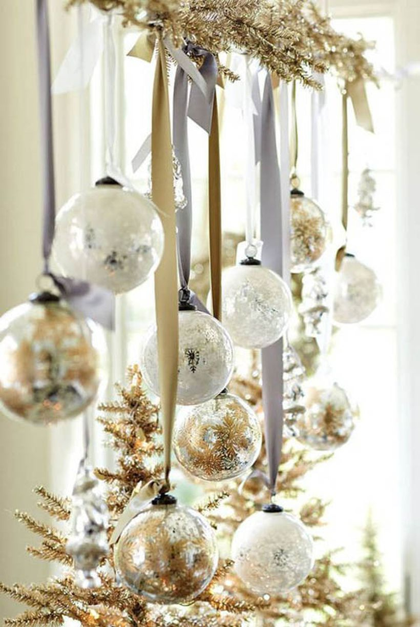 Christmas window with gold and white hanging ornament