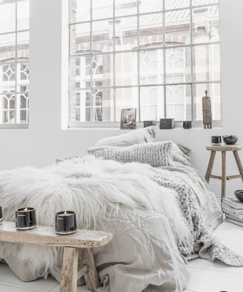 Faux-fur-candles-bowls-and-a-rough-wooden-bench-plus-a-knit-pillow-are-ideal-for-a-winter-like-scandinavian-bedroom