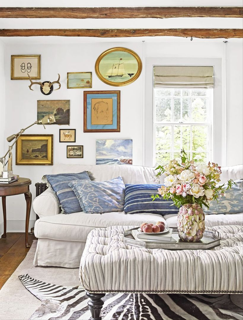White stripped in the blue cushion with white sofa and stripped sofa table