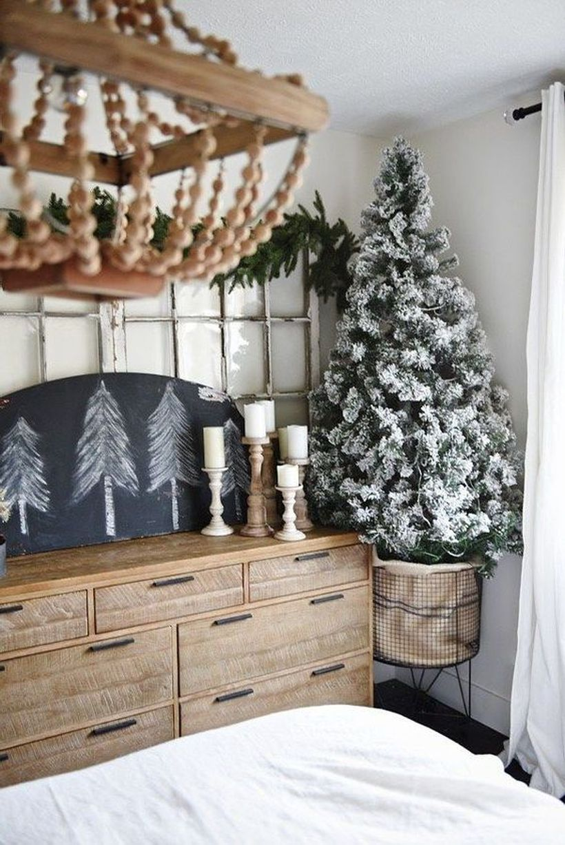 07-a-small-flocked-christmas-tree-in-a-metal-wire-basket-with-no-decor-at-all-it-looks-cool-without-it