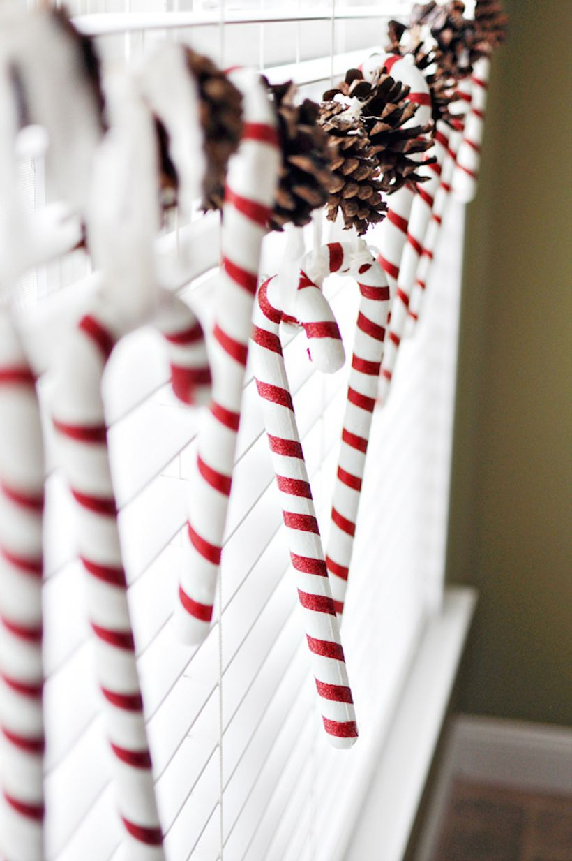 3candy-canes-and-pinecones-hung-in-a-window