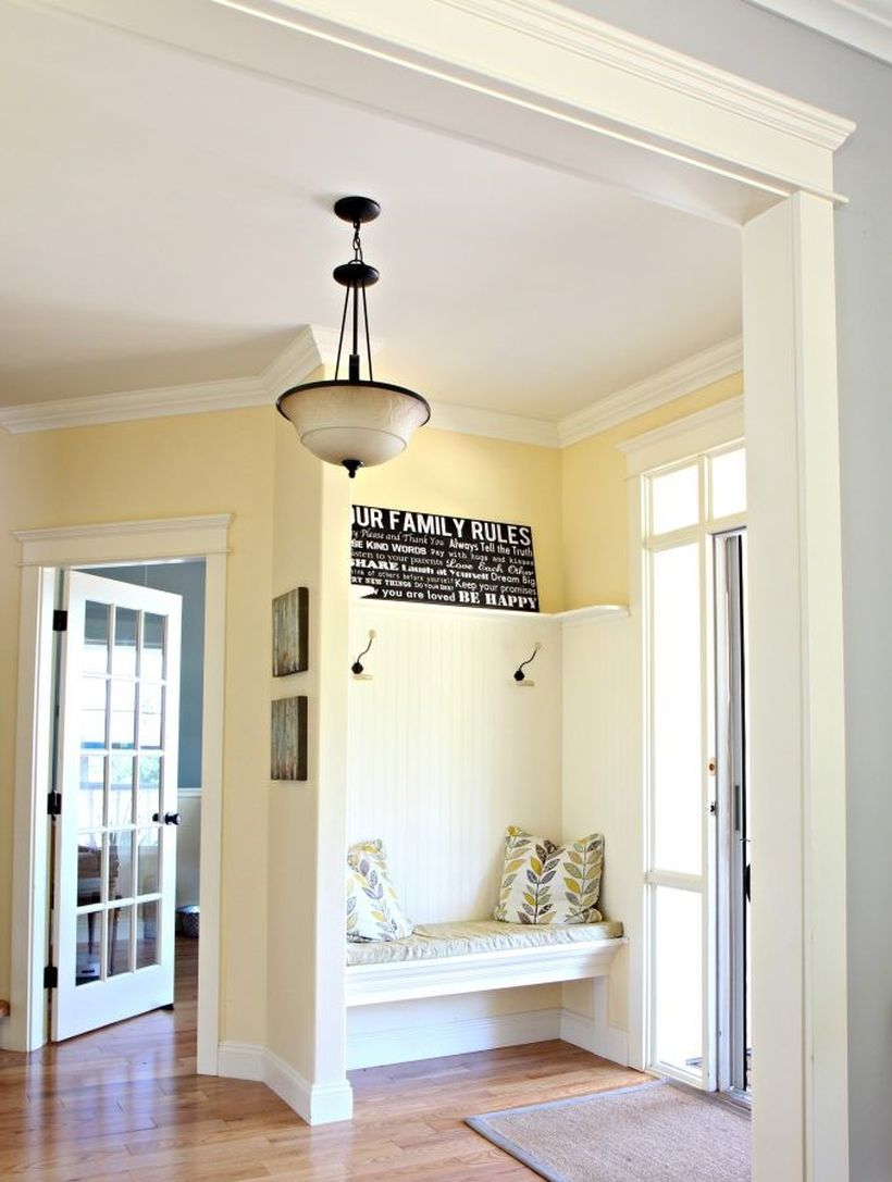 Best-yellow-paint-colour.-benjamin-moore-buttermilk.-oak-flooring.-country-style-foyer-entryway-with-built-in-bench-and-hooks.-kylie-m-e-design-online-colour-consultant-683x1024