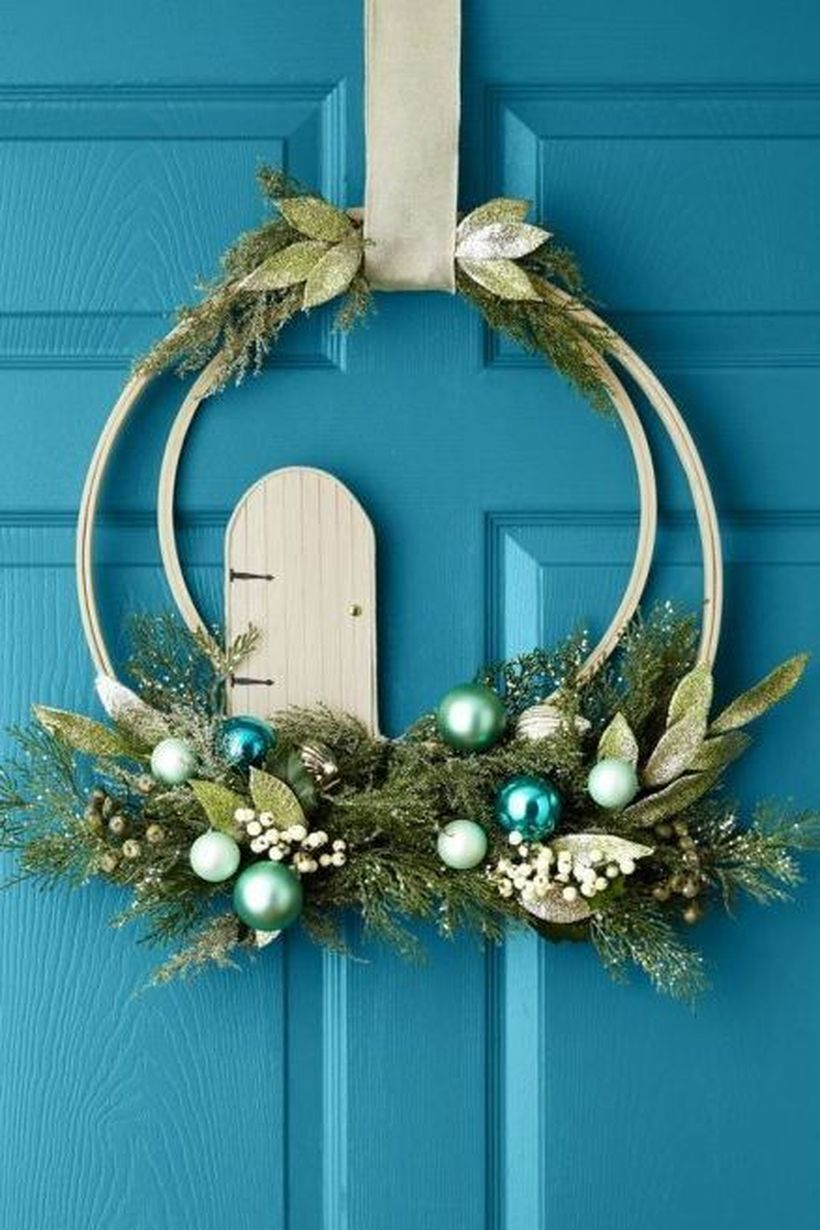 Welcoming-christmas-front-door-with-wreath-blue-is-a-beautiful-unexpected-color-choice-for-a-christmas-wreath.