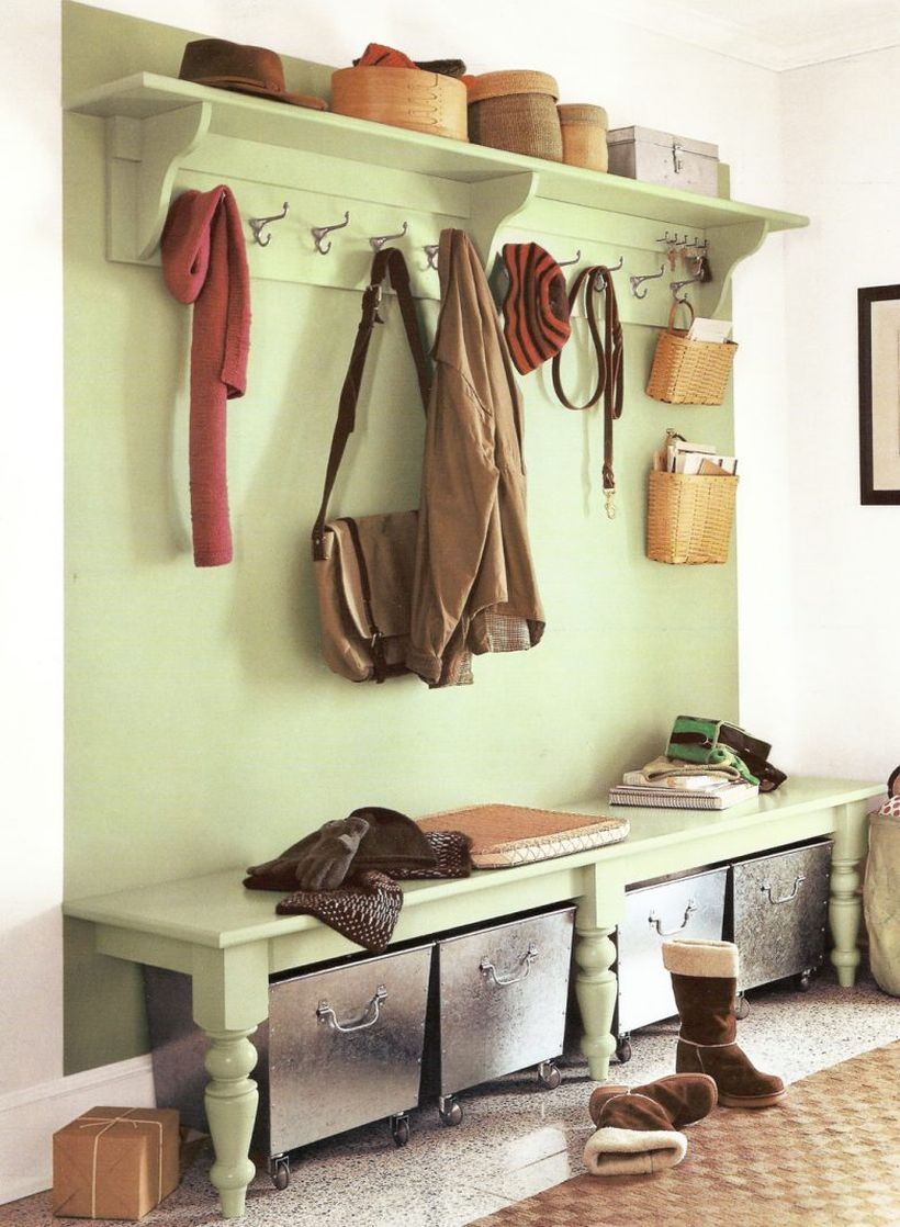 Light-green-wood-entryway-bench-seat-design-with-coat-rack-and-clothing-hooks-above-metal-basket-storage-with-wheels-ideas-783x1068