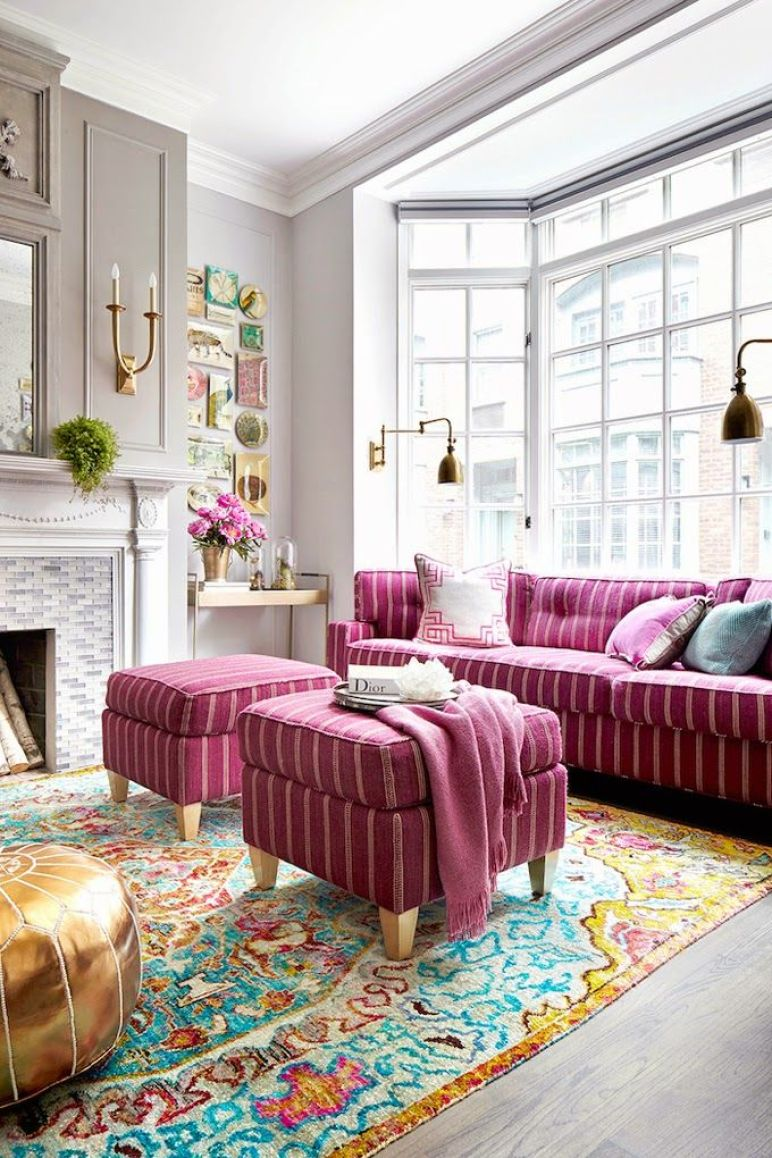 1-pink-sofa-and-ottomans-on-colorful-rug